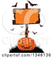 Clipart Of A Carved Halloween Jackolantern Pumpkin Under A Blank Sign With Flying Bats Royalty Free Vector Illustration