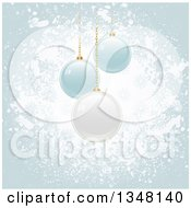 Clipart Of 3d Suspended White And Blue Christmas Baubles Over Grunge Royalty Free Vector Illustration by elaineitalia