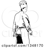 Rear View Of A Black And White Female Chef