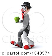 Clipart Of A 3d White And Black Clown Holding A Green Bell Pepper And Walking To The Left Royalty Free Illustration
