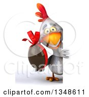 Clipart Of A 3d White Chicken Holding A Chocolate Easter Egg Around A Sign Royalty Free Illustration by Julos