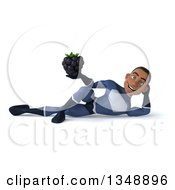 Clipart Of A 3d Young Black Male Super Hero Dark Blue Suit Holding A Blackberry And Resting On His Side Royalty Free Illustration by Julos