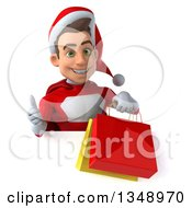 Clipart Of A 3d Young White Male Super Hero Santa Holding Shopping Bags And Giving A Thumb Up Over A Sign Royalty Free Illustration by Julos