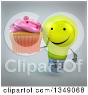 Clipart Of A 3d Happy Yellow Light Bulb Character Holding A Pink Frosted Cupcake Over Gray Royalty Free Illustration