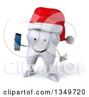 Clipart Of A 3d Happy Christmas Tooth Character Wearing A Santa Hat Shrugging And Holding A Smart Phone Royalty Free Illustration