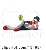 Clipart Of A 3d White And Black Clown Holding A Green Bell Pepper And Resting On His Side Royalty Free Illustration