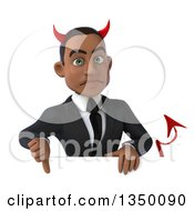 Clipart Of A 3d Young Black Devil Businessman Giving A Thumb Down Over A Sign Royalty Free Illustration