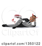 Clipart Of A 3d Young Black Devil Businessman Holding A Beef Steak And Resting On His Side Royalty Free Illustration