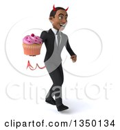 Clipart Of A 3d Young Black Devil Businessman Holding A Cupcake And Walking To The Right Royalty Free Illustration