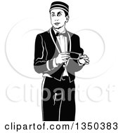 Clipart Of A Black And White Bellboy Or Bellhop Hotel Worker Man Holding A Cash Tip Royalty Free Vector Illustration by dero