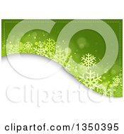 Clipart Of A Green Blue Christmas Background Of Snowflakes And Flares Over A White Hill Royalty Free Vector Illustration