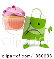 Clipart Of A 3d Unhappy Green Shopping Or Gift Bag Character Giving A Thumb Down And Holding A Pink Frosted Cupcake Royalty Free Illustration by Julos
