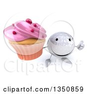 Clipart Of A 3d Happy Golf Ball Character Holding Up A Thumb And A Pink Frosted Cupcake Royalty Free Illustration by Julos