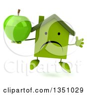 Clipart Of A 3d Unhappy Green Home Character Holding An Apple And Jumping Royalty Free Illustration