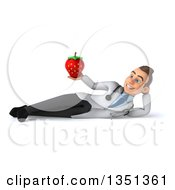 Clipart Of A 3d Young Brunette White Male Nutritionist Doctor Holding A Strawberry And Resting On His Side Royalty Free Illustration