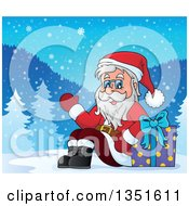 Clipart Of A Cartoon Christmas Santa Claus Waving And Sitting With A Gift In The Snow Royalty Free Vector Illustration