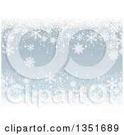 Christmas Background Of White Snowflakes On Light Blue