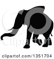 Clipart Of A Black Silhouetted Elephant Walking 6 Royalty Free Vector Illustration
