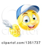 Clipart Of A 3d Yellow Male Smiley Emoji Emoticon Plumber Or Mechanic Face Holding An Adjustable Wrench Royalty Free Vector Illustration