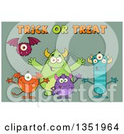 Clipart Of A Group Of Welcoming Monsters With Trick Or Treat Halloween Text Over Green Royalty Free Vector Illustration