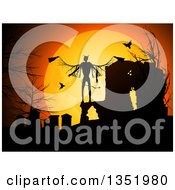Halloween Background Of A Silhouetted Devil In A Cemetery With Vampire Bats Against An Orange Full Moon