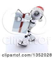 Clipart Of A 3d Futuristic Robot Wearing A Christmas Santa Hat And Carrying A Big Gift On A Shaded White Background Royalty Free Illustration