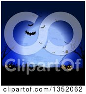 Halloween Background Of Jackolantern Pumpkins In A Cemetery Under A Full Moon With Bats Bare Trees And An Owl