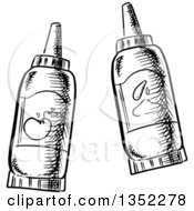 Clipart Of Black And White Sketched Ketchup And Mustard Bottles Royalty Free Vector Illustration