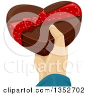 Clipart Of A Mans Hand Holding A Valentines Day Heart Shaped Chocolate Box Royalty Free Vector Illustration