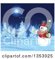 Clipart Of A Christmas Snowman Holding A Small Tree And Presenting A Winter Forest At Night With Snow Flocked Evergreens And Magic Royalty Free Vector Illustration