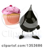 3d Oil Drop Character Holding And Pointing To A Cupcake On A White Background
