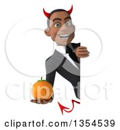 Clipart Of A 3d Young Black Devil Businessman Holding A Navel Orange Around A Sign On A White Background Royalty Free Vector Illustration
