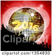 Silhouetted Crowd Of Hands Over A 3d Gold Disco Ball And New Year 2016 On Red