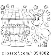 Outline Clipart Of A Cartoon Black And White Reindeer By A Hay Rack Feeder In The Snow Royalty Free Lineart Vector Illustration
