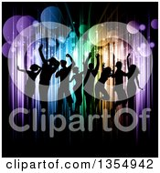 Clipart Of A Silhouetted Crowd Of Young People Dancing Over Colorful Vertical Lights And Flares On Black Royalty Free Vector Illustration by KJ Pargeter