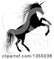 Clipart Of A Silhouetted Black Unicorn Rearing Royalty Free Vector Illustration
