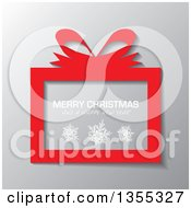 Clipart Of A Red Gift Box With Snowflakes And Merry Christmas And A Happy New Year Greeting Over Gray Royalty Free Vector Illustration by michaeltravers