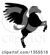 Clipart Of A Black Silhouette Of A Rearing Winged Pegasus Horse Royalty Free Vector Illustration