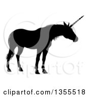 Clipart Of A Black Silhouetted Mythical Unicorn Royalty Free Vector Illustration