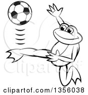 Clipart Of A Cartoon Black And White Frog Kicking A Soccer Ball Royalty Free Vector Illustration by Lal Perera
