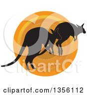Clipart Of Silhouetted Kangaroos Hopping Over A Sunset Royalty Free Vector Illustration