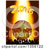 Silhouetted Crowd Of Hands Under A 3d Gold Disco Ball And New Year 2016 With Light Shining Down