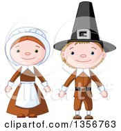 Clipart Of A Happy Thanksgiving Pilgrim Boy And Girl Royalty Free Vector Illustration