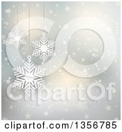 Clipart Of A Suspended Snowflakes Over A Flare Star And Snowflake Background Royalty Free Vector Illustration