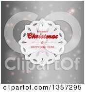 Clipart Of A White Paper Snowflake With Merry Christmas And Happy New Year Text Over A Gray Background With Flares Royalty Free Vector Illustration by elaineitalia
