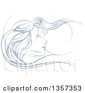 Beatiful Womans Face In Profile With Long Hair Waving In The Wind