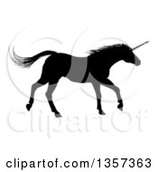 Clipart Of A Black Silhouetted Unicorn Horse Running To The Right Royalty Free Vector Illustration by AtStockIllustration