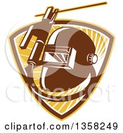 Clipart Of A Retro Welder Visor Mask Rold Holder With Cable And Electrode In A Shield Of Sunshine Royalty Free Vector Illustration