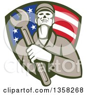 Clipart Of A Retro Male Mechanic Holding A Giant Wrench Over His Chest In An American Flag Shield Royalty Free Vector Illustration