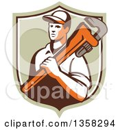 Clipart Of A Retro Male Plumber Holding A Giant Monkey Wrench Over His Shoulder In A Shield Royalty Free Vector Illustration